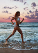 girl runs along the beach