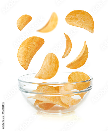 Bowl of potato chips isolayed on white