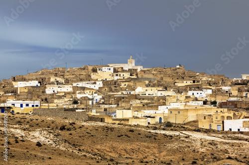 Keuken foto achterwand Tunesië The town Matmata in Tunisia amid lightning sky