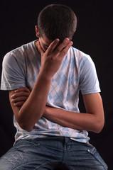 Upset caucasian teen with hand on head