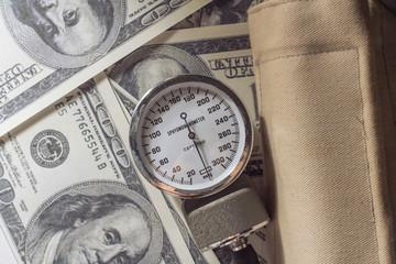 Sphygmomanometer on money.