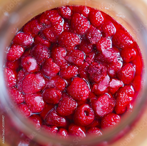 raspberries in jar