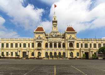 Ho Chi Minh City city hall with Vietnamese flag on top.