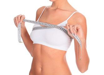 Slim woman in white underwear with tape measure, copyspace