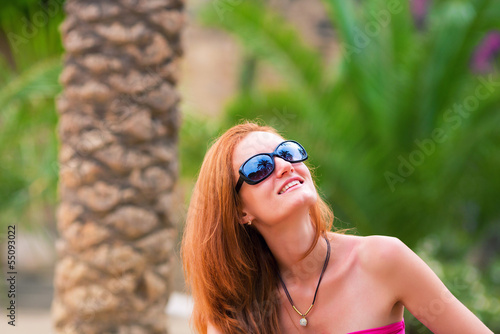 Happy girl on tropical resort