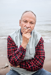 elderly man on the beach on a foggy day