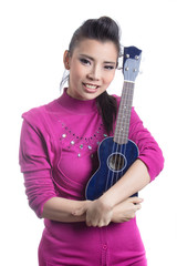 young women play ukulele