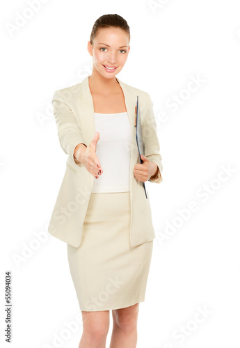 Businesswoman with clipboard offering handshake