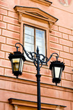 Refurbished fragment of ancient buildings in Warsaw and lantern poster