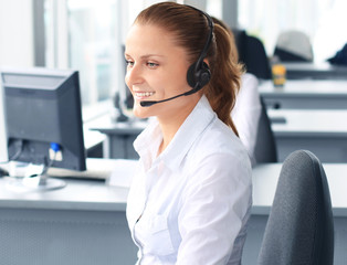Beautiful young female call center operator