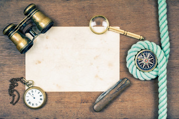 Binoculars, compass, paper, watches, knife, magnifying glass