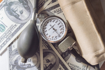 Sphygmomanometer and money.