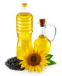 Jug and bottle with sunflower oil with seeds isolated