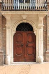 Renaissance front door in Urbino, Italy