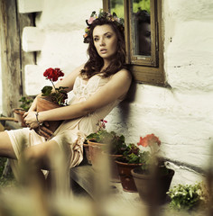 Pure  brunette woman with flowers