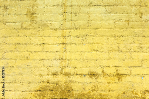 yellow painted old brick wall