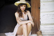 Beautiful brunette woman with straw hat