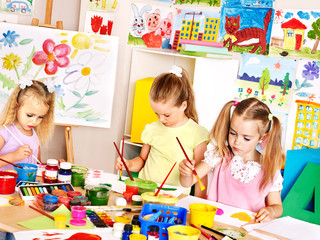 Children painting  at school.