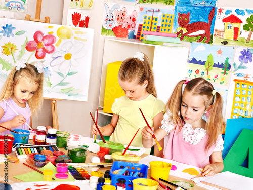 Children painting  at school.