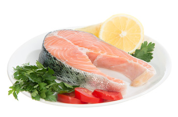 Raw fresh salmon steaks red fish on a plate