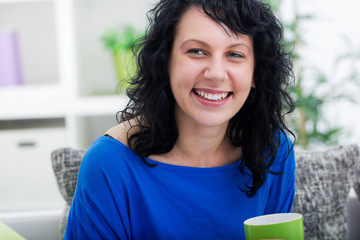 young women at home drink coffee and relaxing