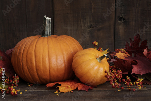 Small pumpkins on wood table