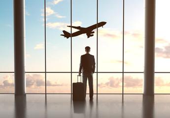 businessman looking in airplane