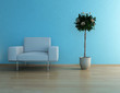 White armchair in front of blue wall and houseplant