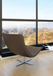 Relax chair against huge window with landscape view