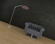 Cozy black armchair against dark stone wall