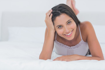Portrait of a beautiful woman relaxing lying in bed