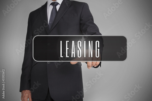 Businessman selecting label with leasing written on it