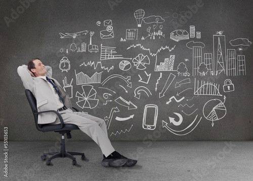 Relaxed businessman sitting on a chair