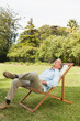 Happy man resting in sun lounger