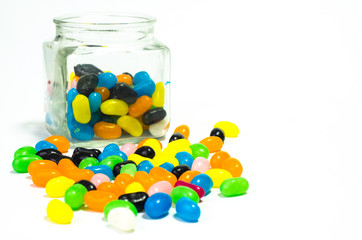 Jelly beans sugar candy snack in a jar isolated on white..