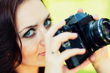 Brunette girl and retro camera