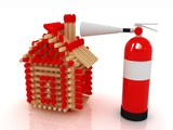 Red fire extinguisher and log house from matches
