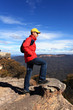 Bushwalker hiker looking out over mountain valley views