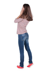 Back view of shocked woman in blue jeans. upset young brunete gi