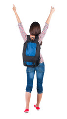 Back view of brunette woman with backpack thumbs up.