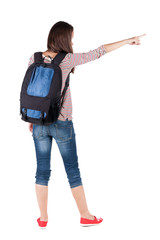 Back view of  pointing woman with backpack looking up.