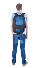 Back view of man with  backpack looking up.