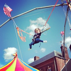 child enjoying fancy fair