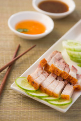 chinese roast pork close up shot served with chilli sauce
