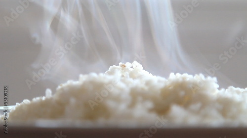 white steam rice with smoke, asian food.