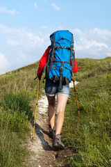 Hiking young woman with backpack