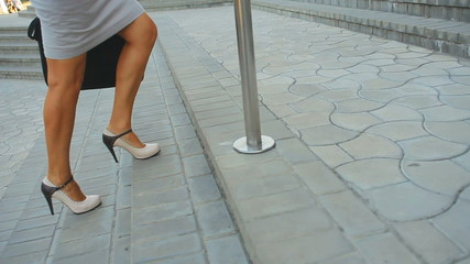 Filmed feet only. woman walking to the office and back