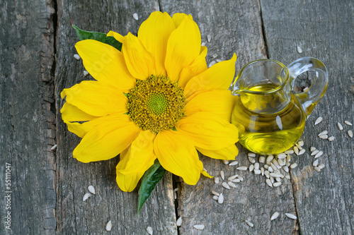 sunflower seed oil on wooden surface