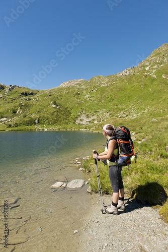 Hiker girl by a mountain lake