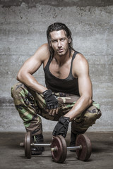 handsome muscle man wearing camouflage pants